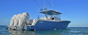 Invincible boat anchored offshore with yamaha outboards