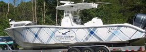 fishing boat branded with buzzards bay body wrap